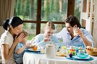 Family eating breakfast togheter