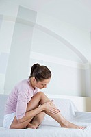woman creaming legs