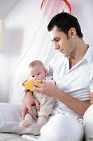 father with infant