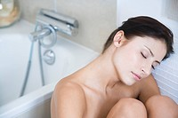 woman relaxing in bathroom