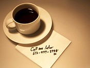 Message on Napkin Beside Coffee Cup