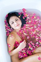 woman taking flower bath