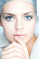 Young woman with silver make up