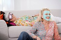 Senior women pampering themselves and relaxing in living room
