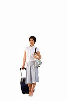 Young female tourist with luggage, smiling, portrait, cut out (thumbnail)