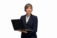 Businesswoman using laptop computer, cut out (thumbnail)