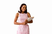 Woman with paperwork, smiling, portrait, cut out (thumbnail)