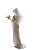 Young woman in wedding dress, holding flowers, cut out (thumbnail)