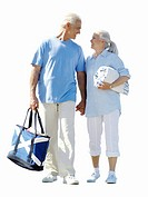 Senior couple walking together with beach towel, cut out (thumbnail)
