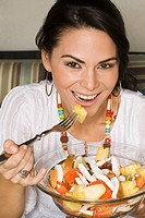 Hispanic woman eating healthy salad