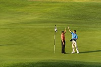 Hispanic men playing golf