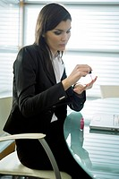 Professional woman with nail polish at desk with laptop (thumbnail)