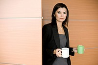 Businesswoman with coffee cups (thumbnail)