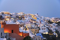 The village of Ia whilst dusk settles in. Oia, Santorini, Cyclades, Greece, Europe