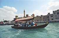 Locals take the Abra, a water taxi that goes back and forth the Creek, connecting Deira and Bur Dubai. Dubai, United Arab Emirates, Southwest Asia