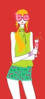 Young woman with sunglasses drinking a cocktail