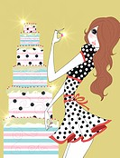 Young woman standing next to tall cake (thumbnail)