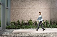 Businesswoman walking to office building