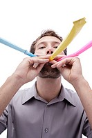 Young man with party blower in mouth, portrait,, close_up