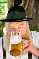 Germany, Bavaria, Upper Bavaria, Man drinking beer in beer garden, portrait, close_up