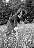 Seventies, black and white photo, people, young woman picks flowers in a flower meadow, aged 25 to 30 years, pulli, skirt, Betina