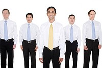 Businessman standing out from a row