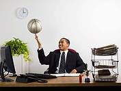 Businessman with basketball (thumbnail)