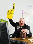 Businessman with giant hand (thumbnail)