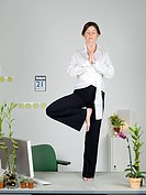 Woman in yoga pose on desk