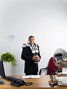 Businessman in american football uniform