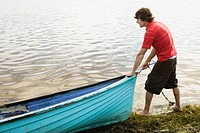 Young man with boat
