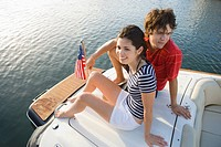 Young couple on boat
