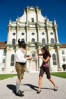 Germany, Bavaria, Upper Bavaria, Asian woman taking picture of Bavarian man with camera phone