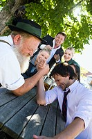 Germany, Bavaria, Upper Bavaria, Two men in beer garden arm wrestling