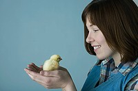 Woman holding a chick
