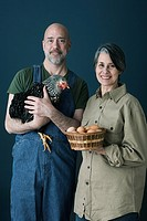 Couple with eggs and chicken