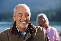 Germany, Bavaria, Walchensee, Senior couple smiling, portrait