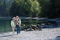 Germany, Bavaria, Walchensee, Senior couple walking across lakeshore