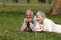 Austria, Karwendel, Senior couple relaxing in meadow