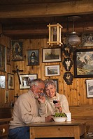 Senior couple sitting at table in Log Cabin (thumbnail)