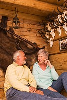 Senior couple in hunting lodge