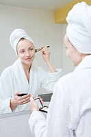 Young woman using make_up brush