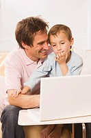 Father and son 4_5 using laptop