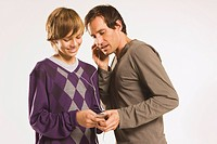 Father and son 13_14 listening to MP3 player
