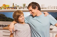 Father and son 13_14 embracing, portrait