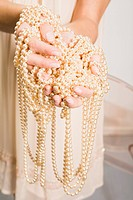 Woman Holding Pearl Jewelry, close_up