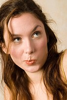 Young woman, pouting, close up