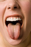 Young woman poking her tongue out, close up