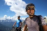 Germany, Bavaria, Karwendel, Couple with mountain bikes, smiling