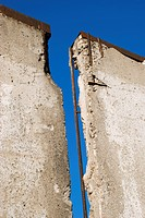 Broken wall against blue sky, close_up